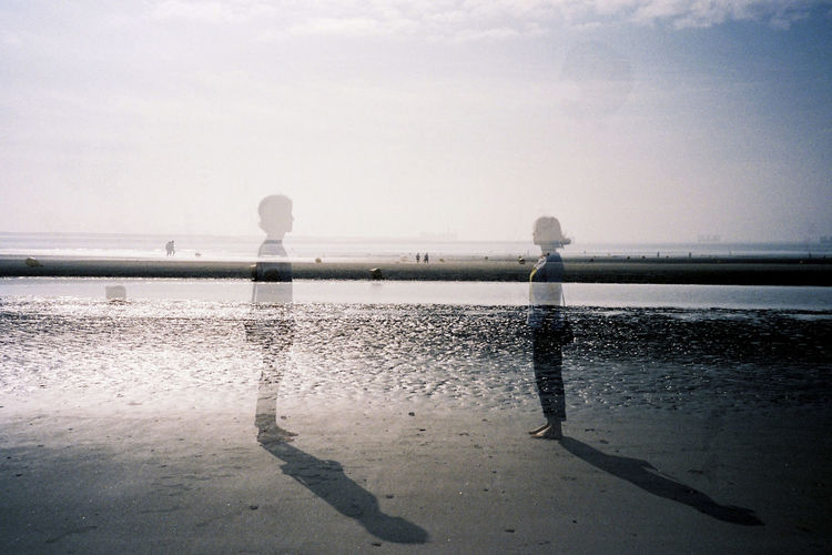 Un moment. Double Exposure Two Is Better Than One Beach Beauty In Nature Childhood Day Full Length Land Leisure Activity Lifestyles Nature Non-urban Scene Outdoors Real People Reflection Scenics - Nature Sea Sky Two People Water Wet