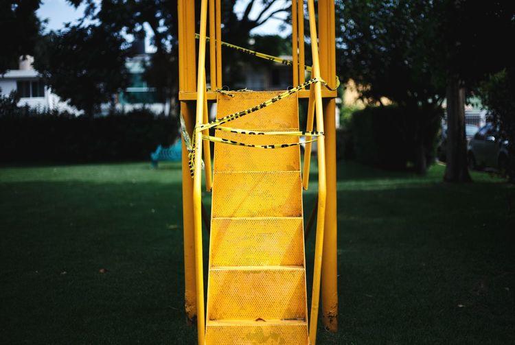 View of yellow slide in playground
