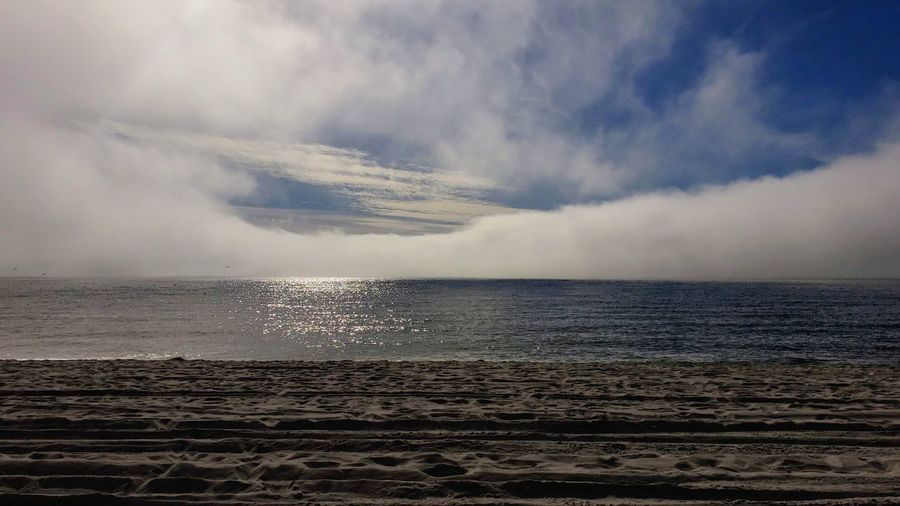 Smoke on the water....... In the sky Water Humpback Whale Sea Beach Sky Horizon Over Water Cloud - Sky