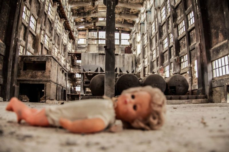 Close-up of doll in abandoned factory