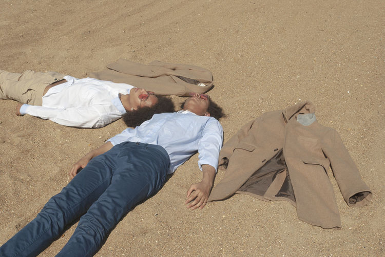 Men Lying Down