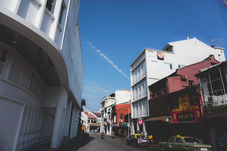Malacca,Malaysia -20 July 2017:Shot of Jonker street Market in Malacca, Malaysia. This is a popular tourist destination. Architecture Blue Building Building Exterior Built Structure Car City Day Incidental People Jonkerwalk Land Vehicle Malacca Malaysia Mode Of Transportation Motor Vehicle Nature Outdoors Residential District Road Sky Street Streetphotography Transportation