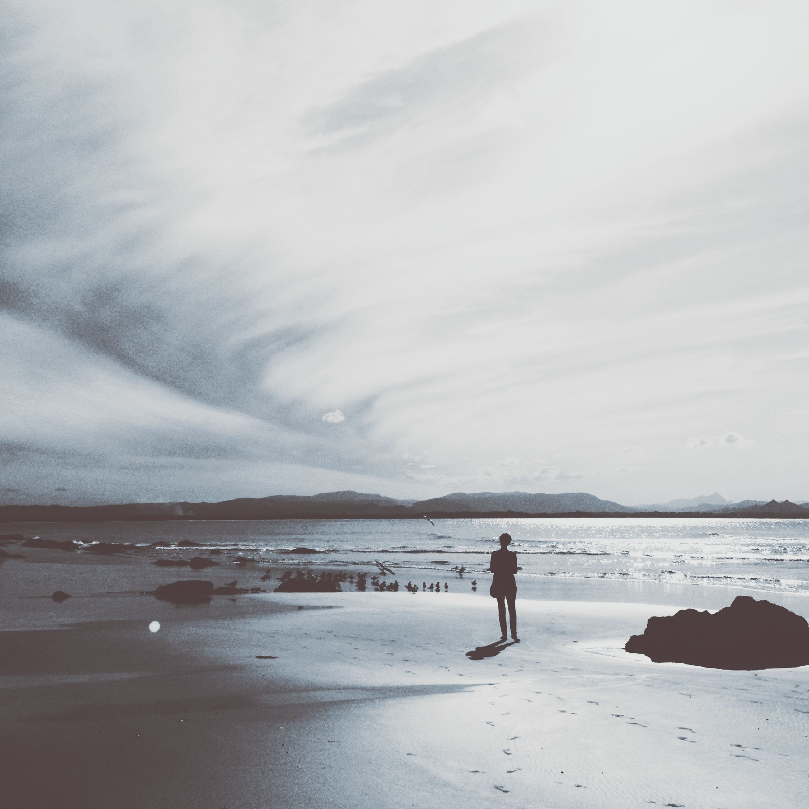 water, sea, beach, sky, shore, tranquil scene, tranquility, scenics, rear view, nature, beauty in nature, standing, lifestyles, sand, leisure activity, cloud - sky, men, idyllic