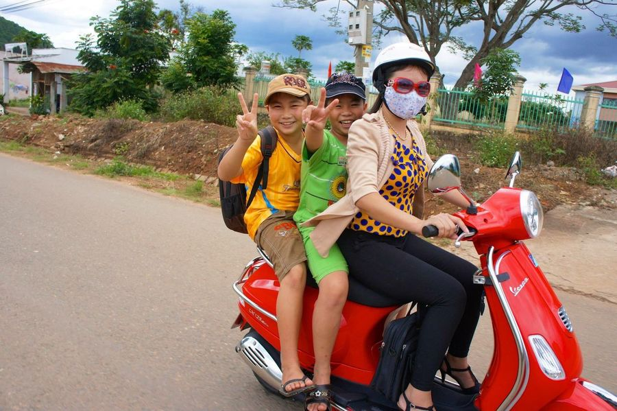Togetherness Sunglasses Transportation Road Smiling Happiness Looking At Camera Friendship Vietnam Scooter