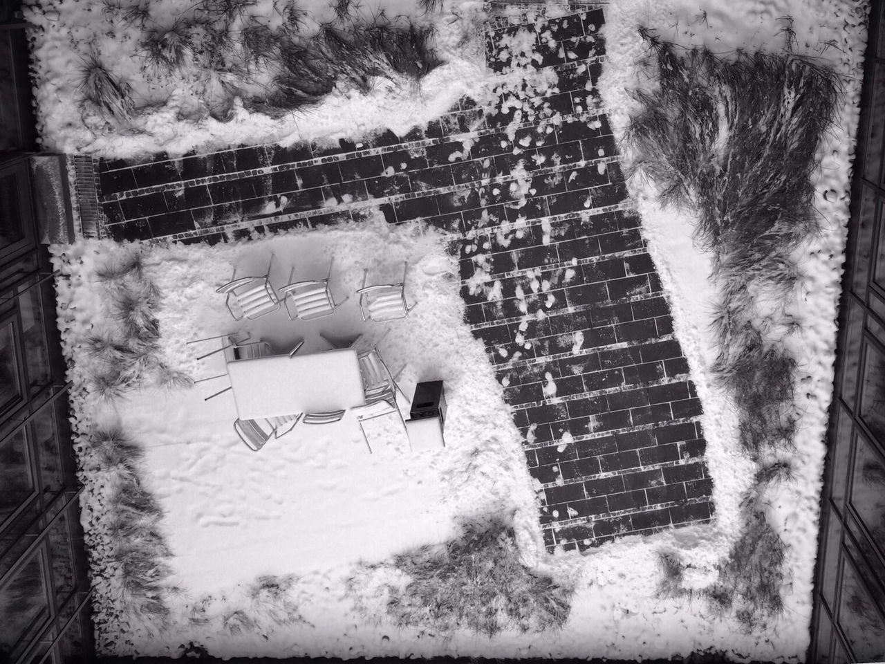 Directly Above Shot Of Chairs And Table On Snow Covered Yard