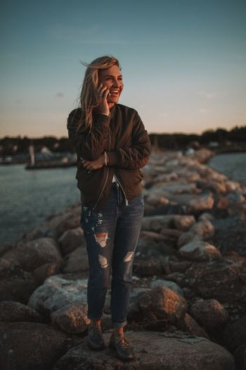 Water Standing Real People Nature Young Women Sea Outdoors Sky Sunset Beauty In Nature People Day Full Length Togetherness Portrait Smiling Happiness One Person Blond Hair