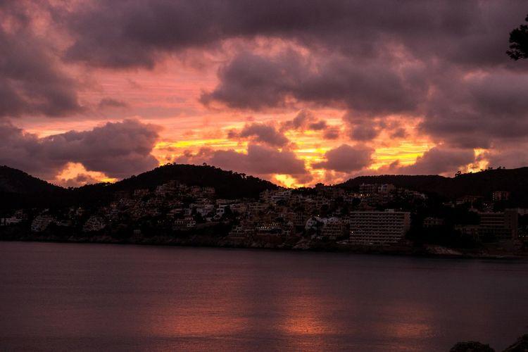 Beauty In Nature Built Structure Burning Sky Burning Sky Sunset Cloud - Sky Mallorca Mountain Nature No People Outdoors Peguera Scenics Sky Storm Cloud Sunset Water