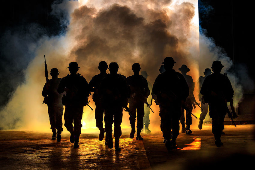 Gun Teamwork Group Group Of People Large Group Of People Lifestyles Men Nature Night Real People Rear View Silhouette Smoke - Physical Structure Soldiers Uniform Standing Togetherness Walking War