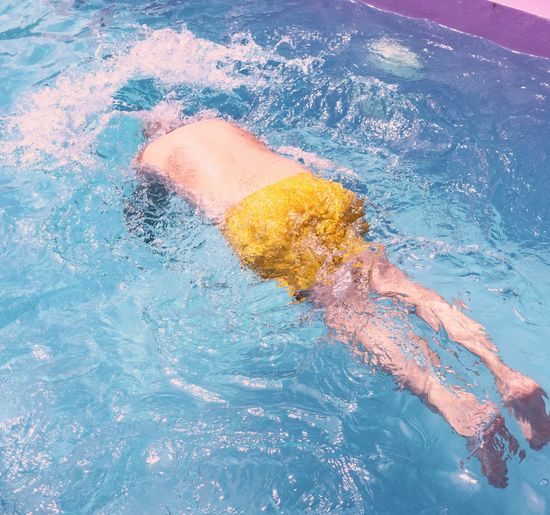 High angle view of person swimming in pool