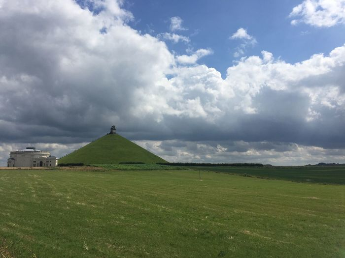 Lion mound against cloudy sky
