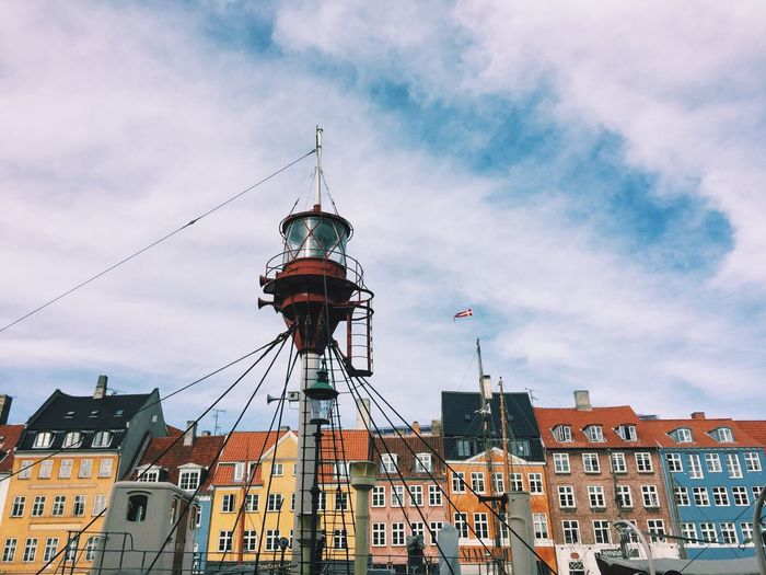 Architecture Built Structure Building Exterior Low Angle View City Sky Tower Window Cloud Cloud - Sky Travel Destinations Day Tall - High Outdoors Spire  No People City Life Development High Section History Copenhagen Copenhagen, Denmark Nyhavn Nyhavnport Colorful