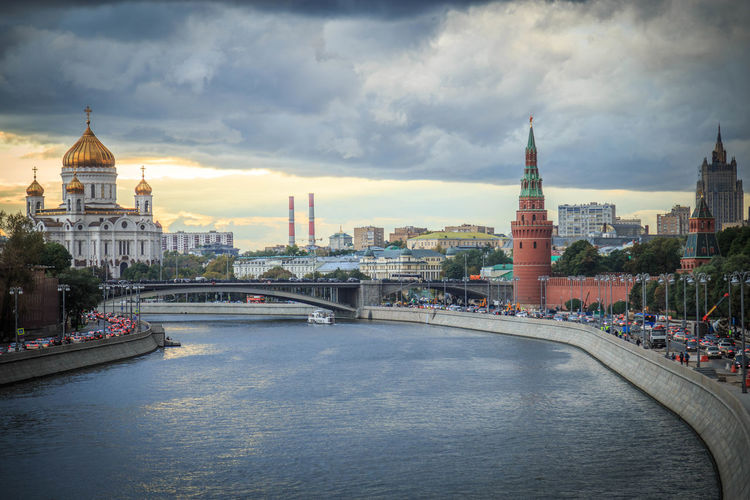 Moscow Russia Built Structure Architecture Cloud - Sky Building Exterior Sky City Water Bridge Place Of Worship River Travel Destinations Religion Nature Connection Bridge - Man Made Structure Building Travel Cityscape No People Outdoors Government Kremlin Church Orthodox Church