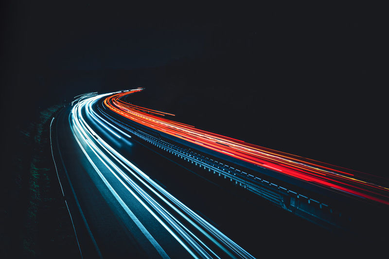 Multi Colored Light Trail Technology Illluminated Motion Long Exposure Brightly Lit Bright Abstarct Night Data Pattern Transportation No People Blue Futuristic Red Innovation Outdoors First Eyeem Photo Photo Day Travel Cars Sky