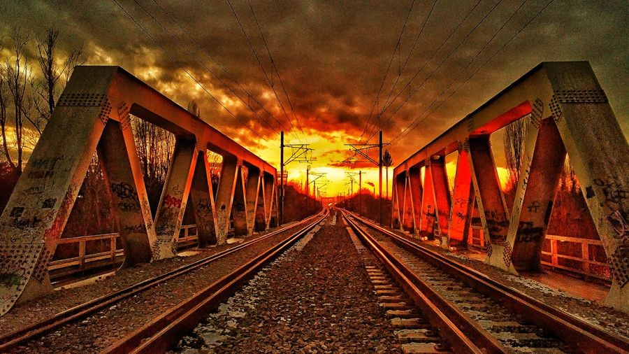 Railway to hell....:DTransportation Sunset Sky Railroad Track Rail Transportation No People Outdoors The Way Forward Illuminated Architecture Day Park Walking Park - Man Made Space Night Transportation Dramatic Sky Bridge Bridge - Man Made StructureRailway Bridge sunset #sun #clouds #skylovers #sky #nature #beautifulinnature #naturalbeauty photography landscape Railroad Station Platform Rail