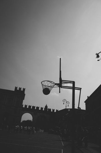 Basketball Built Structure City City Life Courtyard  Day Low Angle View No People Outdoors Silhouette Sky