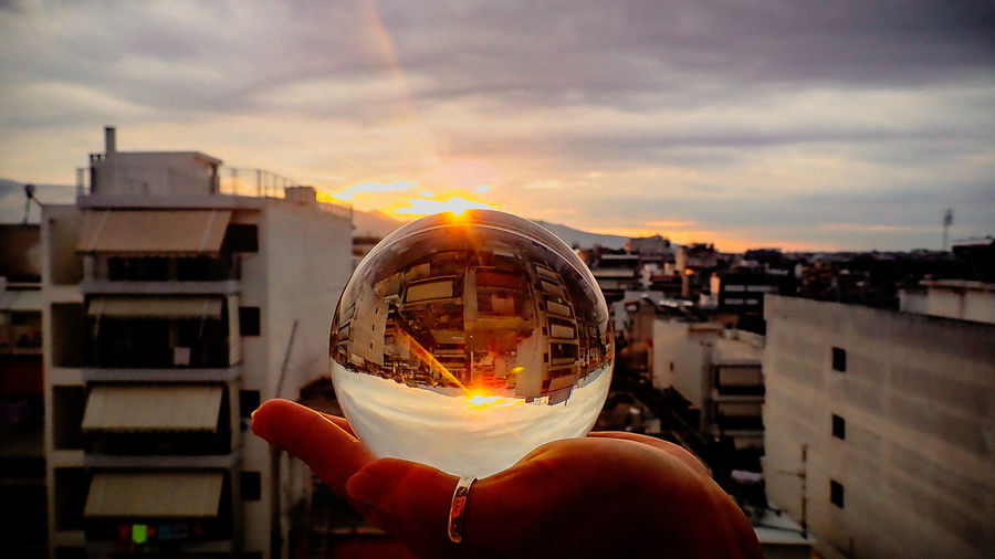 View from home Human Hand Crystal Ball Crystal Ball Photography City Cityscape Olympus Tg5 Penthouse Penthouse View Sunset Sunset_collection Human Hand City Cityscape Technology Pixelated Sunset Astronomy Holding Sky Architecture