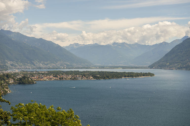 Alpine lake Maggiore with Mountain in a sunny Day in Ticino, Switzerland. High Up Scenic Sunny Alpine Lake Beauty In Nature Day Elevated View Idyllic Lake Lake Maggiore Landscape Mountain Mountain Range Nature No People Outdoors Scenics Sky Swiss Alps Tranquil Scene Tranquility Water