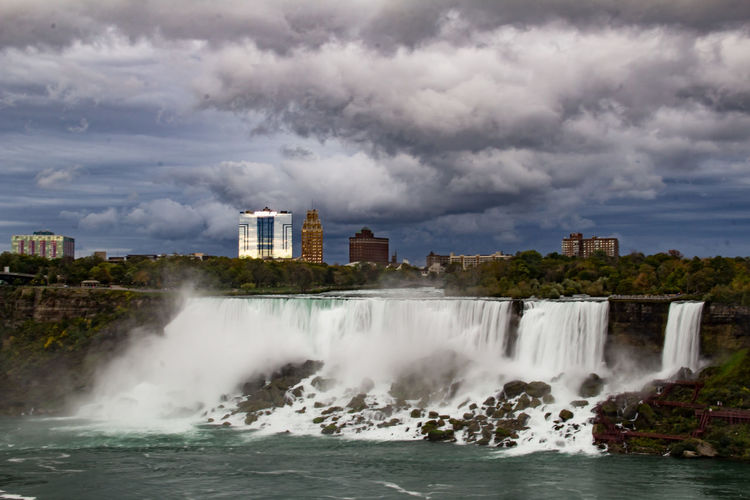 American Falls Niagara Niagara Falls Niagara Falls American Side Architecture Beauty In Nature Building Exterior Built Structure City Cloud - Sky Day Force Motion Nature No People Outdoors Power In Nature Scenics Sky Splashing Water Waterfall