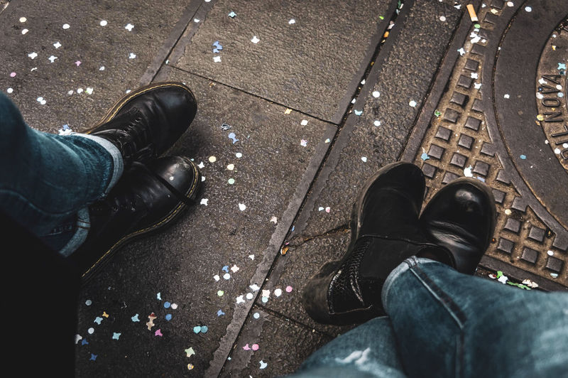 Floor Backgrounds Confetti Carnival Street Photography Outdoors Travel Adult Urban Low Section Standing Human Leg Shoe High Angle View Jeans Personal Perspective Human Foot Footwear Boot Denim Shoelace Pair Tourism Human Feet Legs Crossed At Ankle Things That Go Together Tying Canvas Shoe Tiled Floor Trousers My Best Photo The Street Photographer - 2019 EyeEm Awards