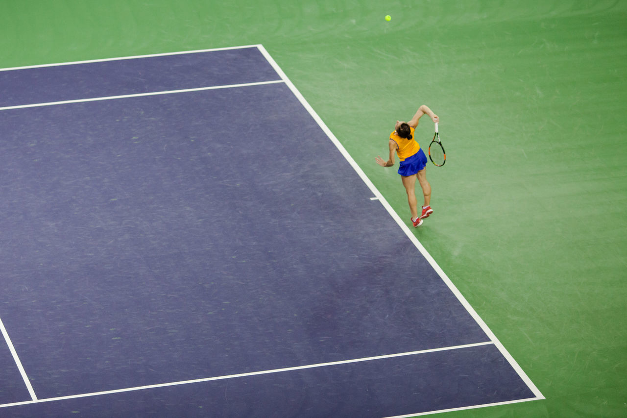 High Angle View Of Woman Playing Tennis On Court