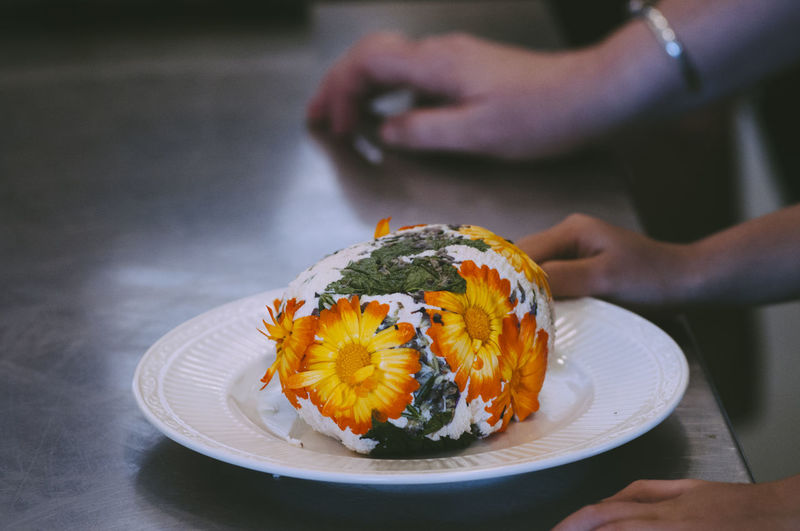 Close-up of food covered with flowers in plate