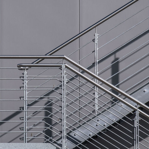 Architecture No People Day Built Structure Railing Metal Building Exterior Staircase Building Steps And Staircases Wall - Building Feature Pattern City Outdoors Connection Repetition Steel Alloy Office Building Exterior