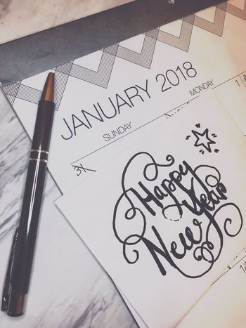 Typography January Goodwill Good Will Greeting Star Calendar Desk Stationary New Beginnings 2018 Happy New Year New Year Handwritten Paper Communication Text Pen Indoors  Handwriting  No People High Angle View Table Close-up Envelope Ink Day