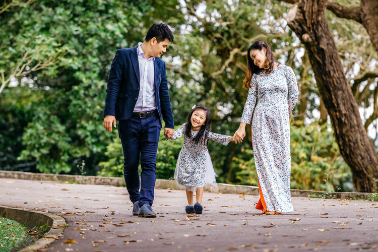 Chic's family 70-200mm Ao Dai Vietnam Happiness Nikon Singapore Adult Bokeh Cheerful Child Childhood Daughter Day Females Full Length Girls Nature Outdoors People Real People Smiling Togetherness Tree Viernamese Women Young Adult