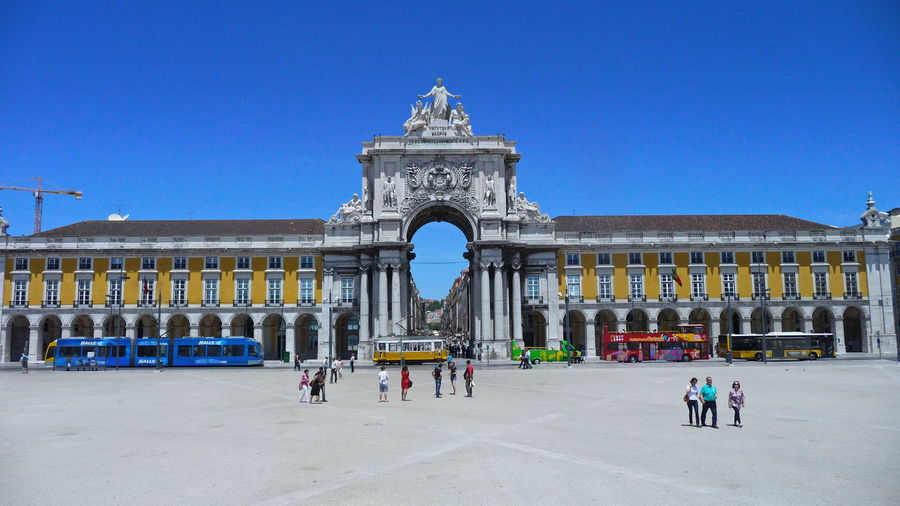 Lissabon, Portugal Praça Do Comércio, Lisboa Arch Architectural Column Architecture Building Exterior Built Structure City Clear Sky Crowd Day Group Of People History Large Group Of People Nature Outdoors Real People Sky The Past Tourism Travel Travel Destinations
