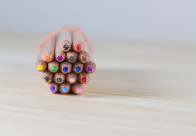 Bunsh of colored pencils Pencils Bunch Close-up Colored Crayons Colored Pencils Large Group Of Objects Multi Colored Stationery Still Life Table Tips Variation Variation Of Red Color Wood - Material