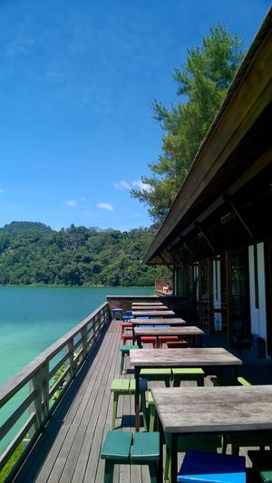 lake view Architecture Balcony Balcony View Blue Boardwalk Building Exterior Danau Linow Food Court Lake Nature Outdoors Railing Sky Tables Tomohon Tomohon View Tranquil Scene Wood - Material