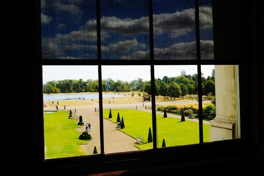 Looking out of the window at Kensington Palace Horizon Sightseeing Spot England Structured Symmetrical Art Historical Building Looking Out Of The Window Copy Space Green Royal Classic Garden Centered Centered Perspective Kensington Palace KensingtonPalace Landscape Travel Destinations Travel Tourism London Uk British View Outside From Inside To Outside Tree Window Court