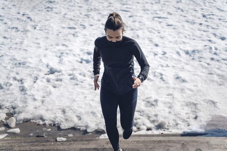 Full length of teenage girl standing on beach