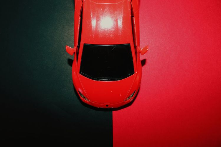 High angle view of electric lamp against red background