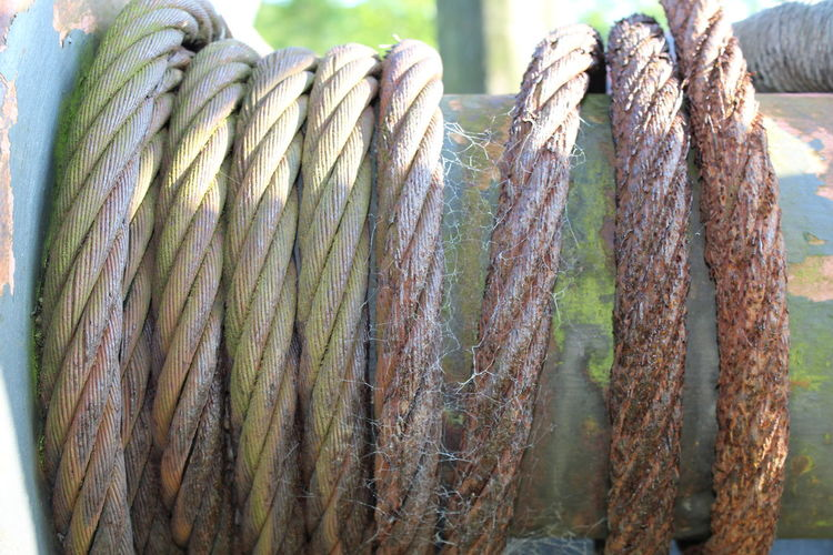 Cable Wrapped Around Mechanism. Cable. Close-up Detail No People Old Part Of Rusty Cable.