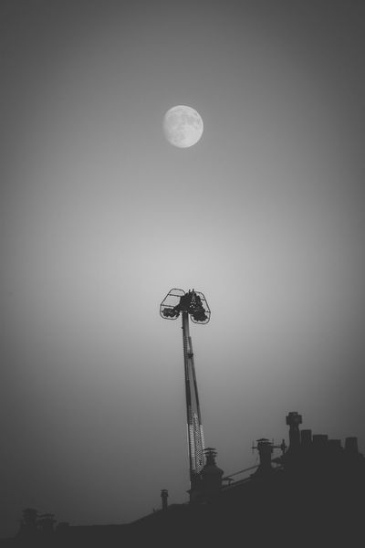 Trying to catch the moon Amusement Park Black And White Blackandwhite Foire Lune Monaco Moon Night Noir Et Blanc Outdoors Sky Super Moon