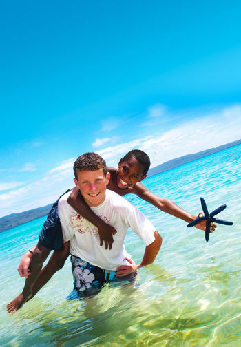 Pele Island Vanuatu Beach Bonding Carefree Enjoyment Fun Getting Away From It All Happiness Harmony Leisure Activity Love Males  Melanesian Pacific Pacific Ocean Son Star Fish Tam Tam Togetherness Tourism Travel Travel Travel Destinations Two People Vacations Vivid International
