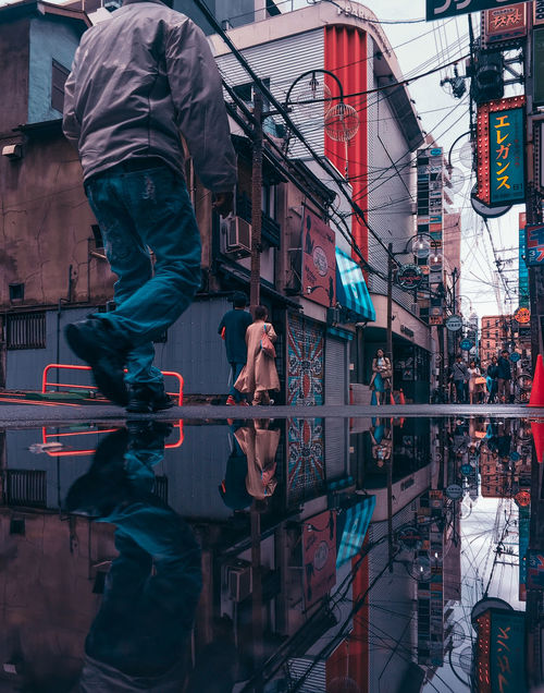 // local scene // Building Exterior Architecture Built Structure City Real People Reflection Window Building Day Outdoors Lifestyles AMPt_community Japan Streetphotography Reflection Mirror EyeEm Best Shots EyeEm Glass - Material People Standing Men Group Of People Representation Clothing Human Representation Digital Composite
