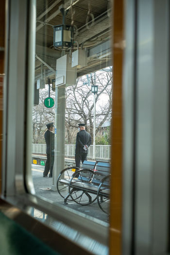 Security Guards Seen Through Window In City