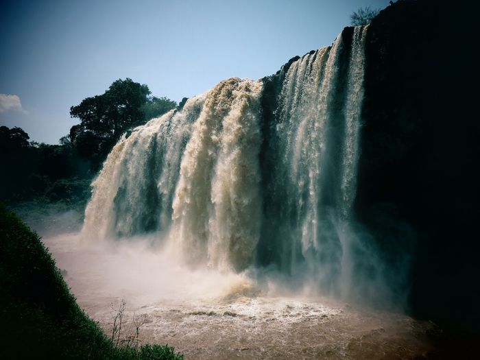 Beauty In Nature Blue Nile Blue Nile Waterfall Day Ethiopia Landscape Long Exposure Motion Nature No People Outdoors Scenics Sky Splashing Spraying Tourism Travel Destinations Tree Water Waterfall