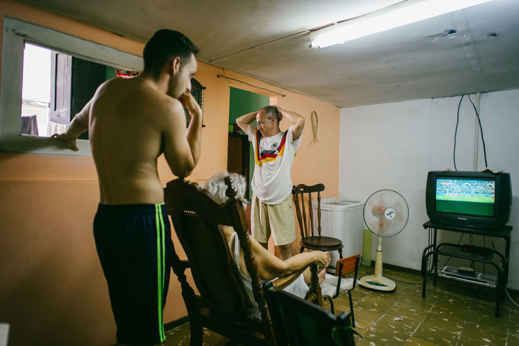 We watched the Worldcup in Cuba~ Adult Casual Clothing Ceiling Hairstyle Human Body Part Illuminated Indoors  Lifestyles Lighting Equipment Love The Game Men Mirror People Real People Seat Shirtless Shorts Standing Table Technology Three Quarter Length Young Adult Young Men