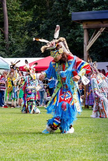 September 3, 2017, American Indian men in traditional clothing, or regalia, dance during a competition at the Kee-Boon-Mein-Kaa Pow Wow in Dowagiac Michigan USA American Indian Native American Culture Native American People Regalia Pow Wow Pow Wow Dancer Culture And Tradition Arts Culture And Entertainment Celebration Clothing Crowd Dancing Day Festival Group Of People Leisure Activity Outdoors People Performance Real People Traditional Dancing Mixed Age Range Clothes Traditional Ceremony Large Group Of People