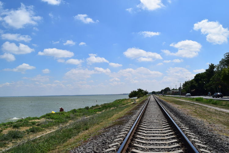 Beauty In Nature Blue Cloud Cloud - Sky Cloudy Grass Landscape Long Nature No People Non-urban Scene Outdoors Railroad Track Railroad Track Railway Remote Scenics Sky The Way Forward Tranquil Scene Tranquility Vanishing Point Diminishing Perspective Azovsea Train