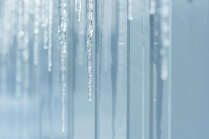Close-up of ice crystal over white background