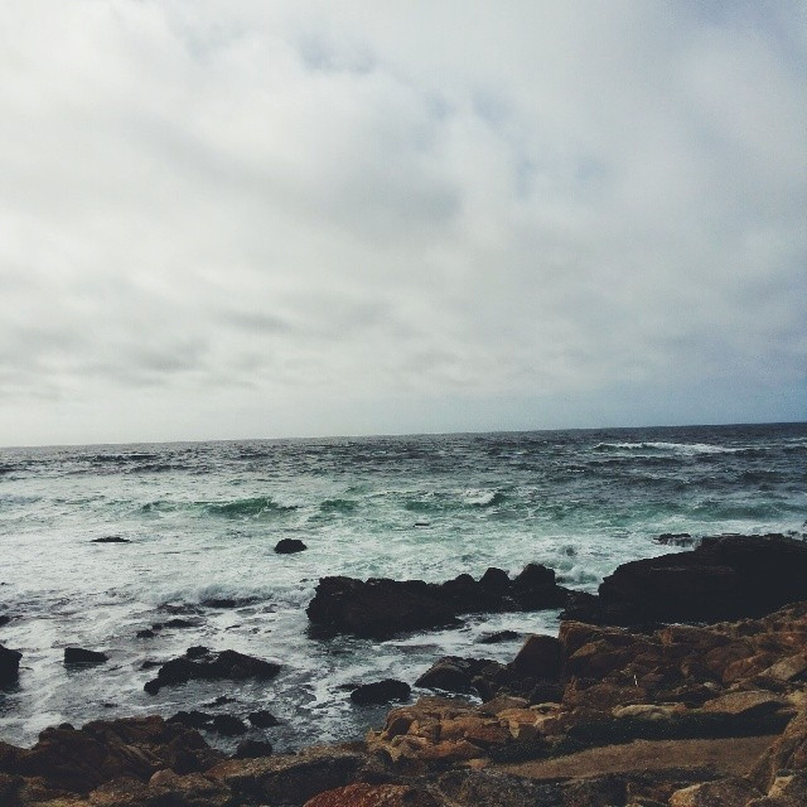 sea, horizon over water, water, sky, scenics, beauty in nature, tranquil scene, tranquility, beach, nature, cloud - sky, wave, shore, rock - object, cloudy, idyllic, cloud, seascape, surf, outdoors