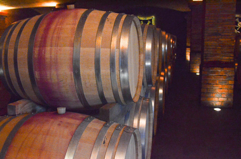 Alcohol Barrel Cellar Cylinder Drink In A Row Indoors  Large Group Of Objects No People Stack Warehouse Wine Wine Cask Wine Cellar Winemaking Winery Wood - Material
