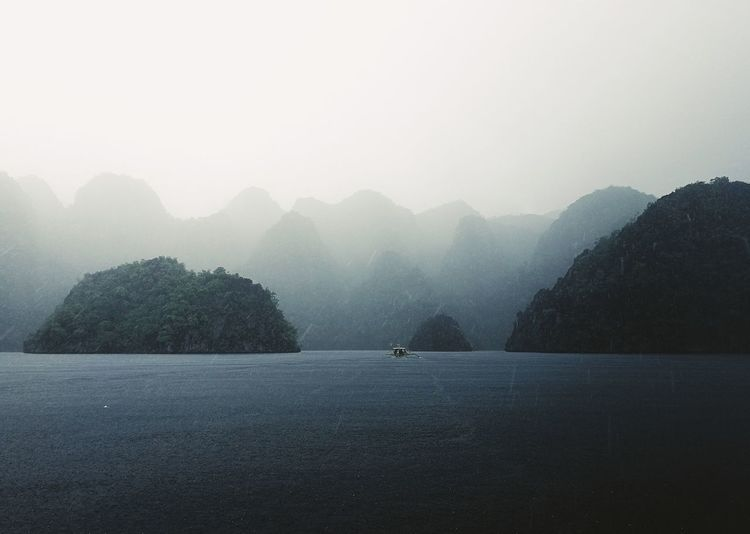 Fog Outdoors Nature Beauty In Nature Water Tree Scenics Lake No People Mountain Day Cold Temperature Sky Sommergefühle Landscape Photography Coron, Palawan Boat Rain Eyeem Philippines EyeEm Selects Lost In The Landscape The Traveler - 2018 EyeEm Awards