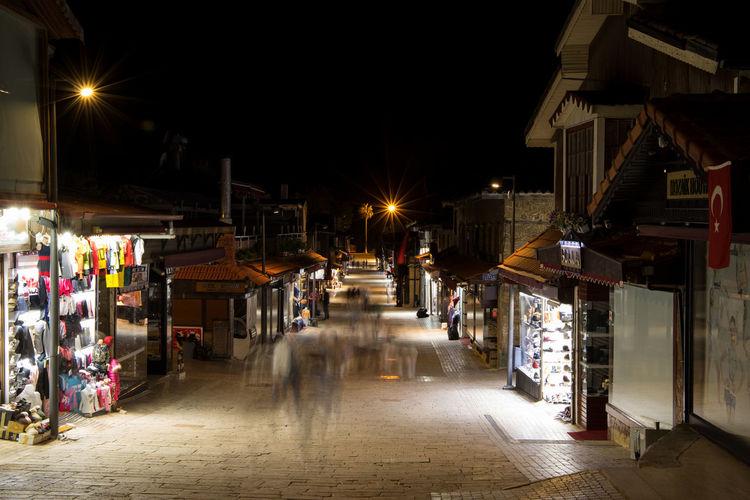 Illuminated street at night