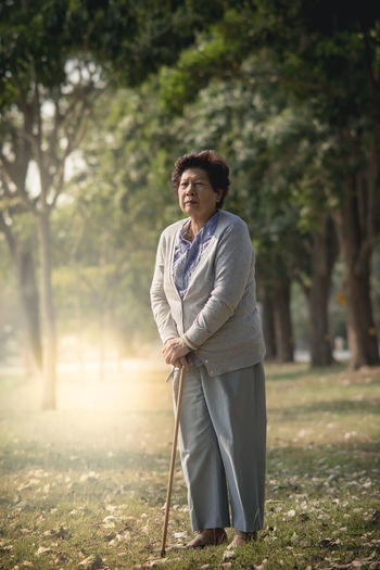 Senior Woman Standing At Park
