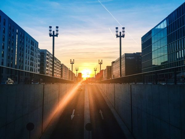 Built Structure Architecture Building Exterior Sunset Sky City Sunlight Outdoors Road Sun No People Underground Garage Ramp Frankfurt Am Main Europaviertel In Frankfurt Am Main Lights Light Flares Modern Blue